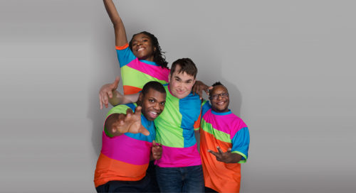 Four people in bright coloured t-shirts