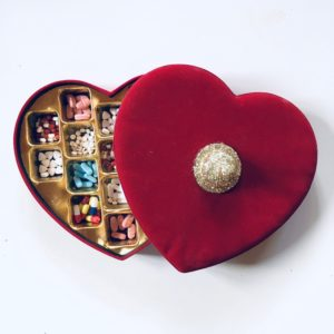 Heart box filled with pills