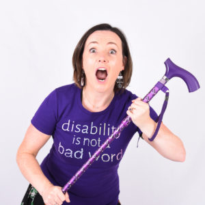 woman with a purple stick
