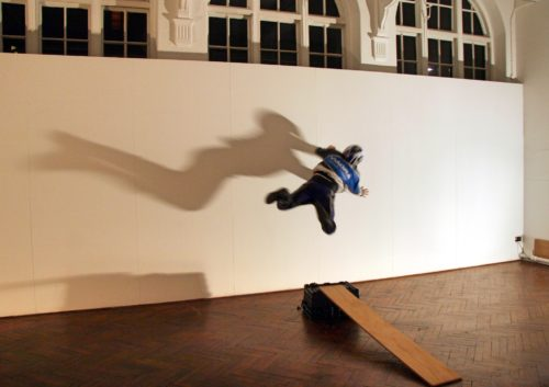 Man jump against a wall