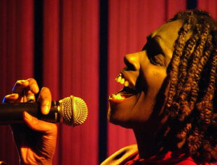 A female singer holds a microphone