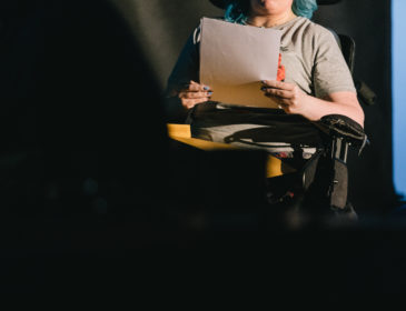 Person reads from script
