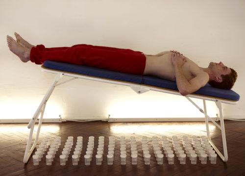 Man lying on a sloped stretcher