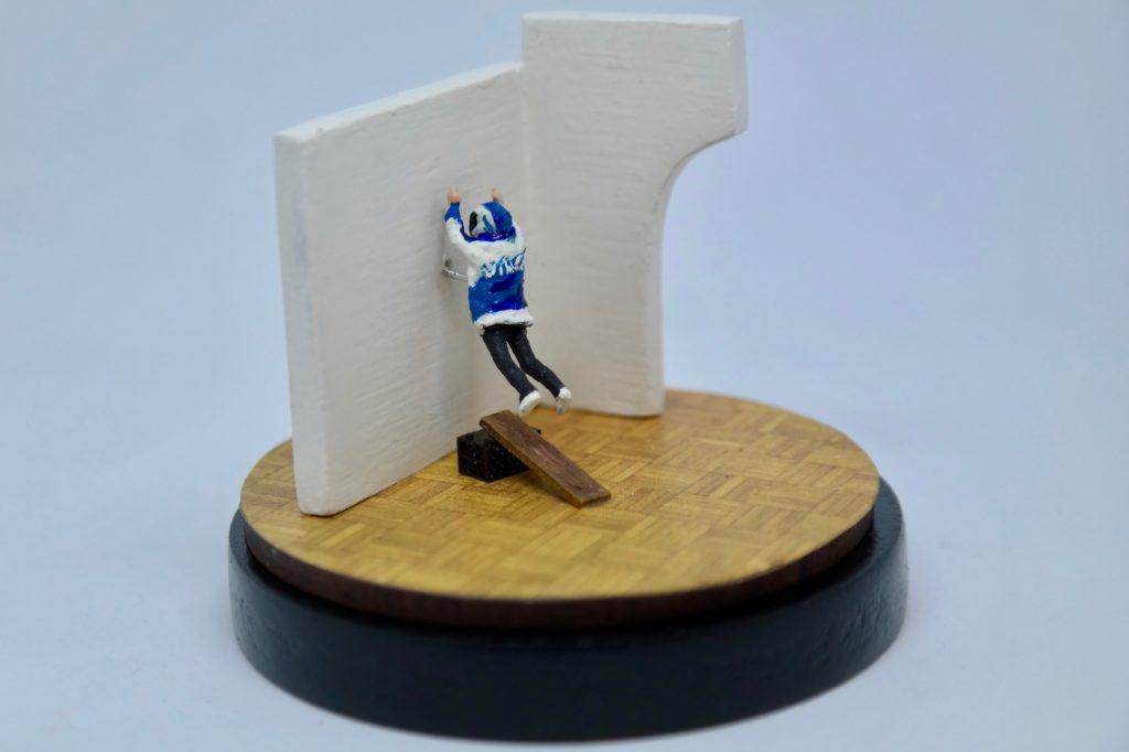 Diorama of person jumping at wall