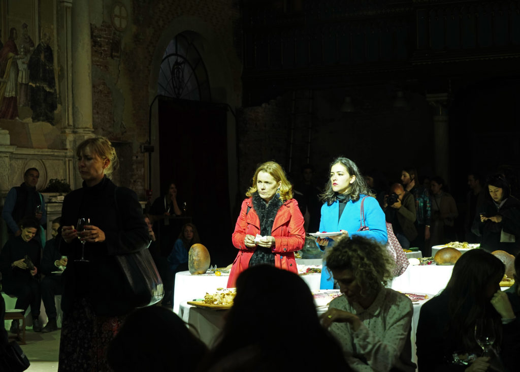Two women presenting to crowd