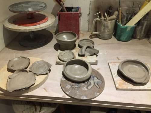 photo of aa series of clay pieces laid out on a table