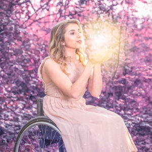 promo photo of a young woman in a wheelchair