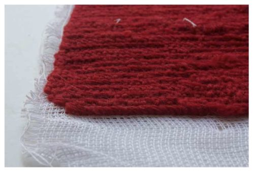 photo of a red knitted square