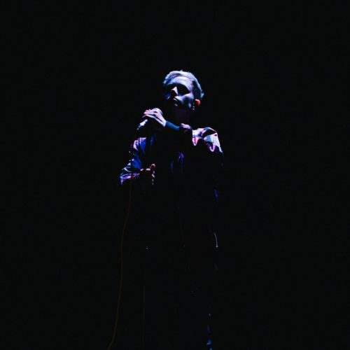 production shot of performer on stage