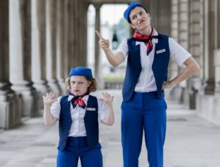 Two dancers dressed as flight attendants