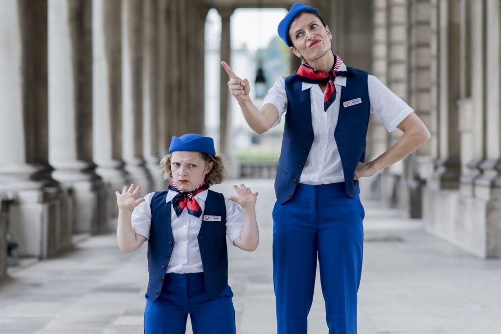 Two dancers dressed as flight attendants