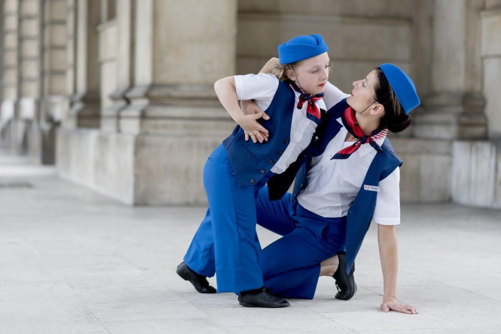 Two flight attendants embrace