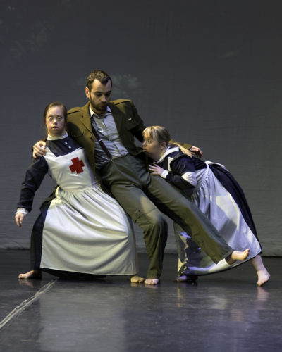 three dancers pose on stage