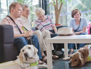 Visually impaired people sitting on sofa