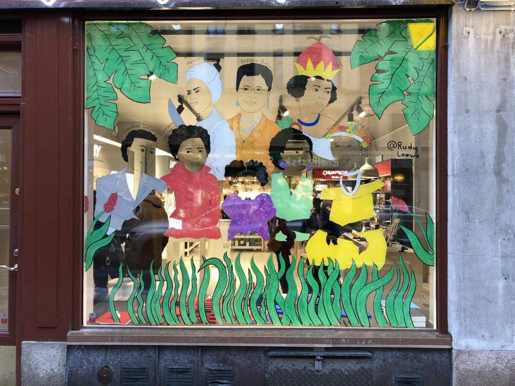 Mural in shop window of famous black women
