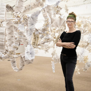 artist portrait with installation