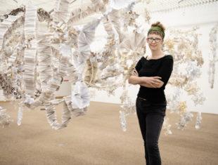 artist portrait with installation