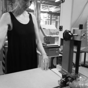 Fae Cutting wood on a bandsaw
