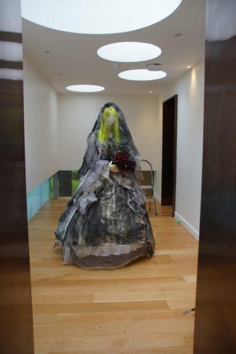 Sculpture showing Miss Havisham in a black wedding dress