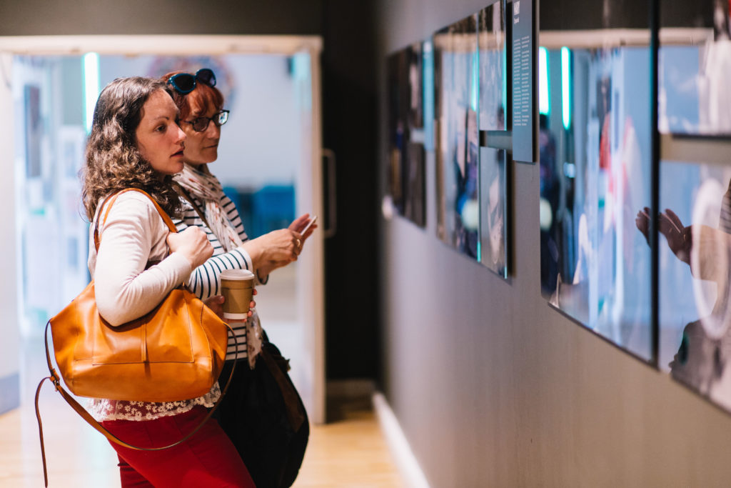 Two women looking at photography exhibition
