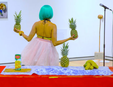 Woman holding pineapples
