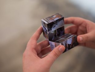 Person holding a rubix cube of photographs