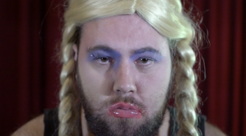 Drag artist with Down syndrome, blonde pigtail wig and beard