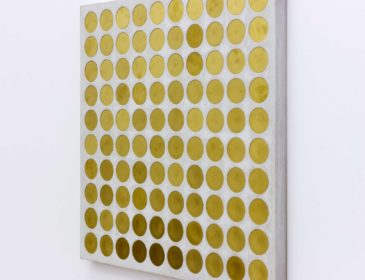 A canvas covered in multiple gold circles