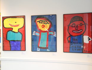 Exhibition shot, showing three colourful self portraits
