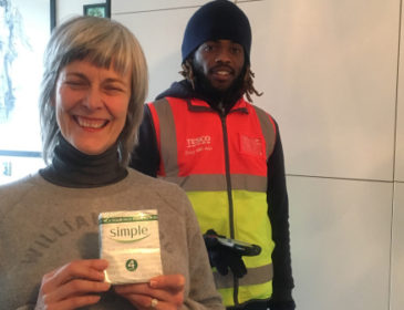Julie holding Simple soap with Tesco Delivery Man