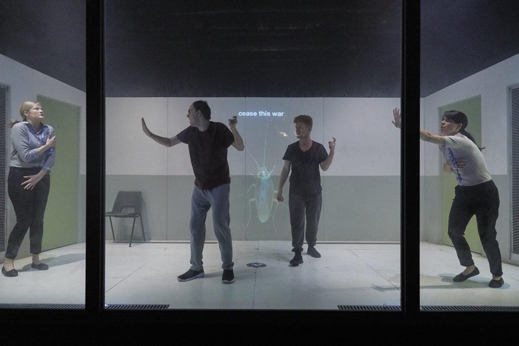 4 actors behind plexiglass 2 are signing