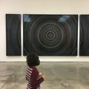 Small child admiring a piece of art