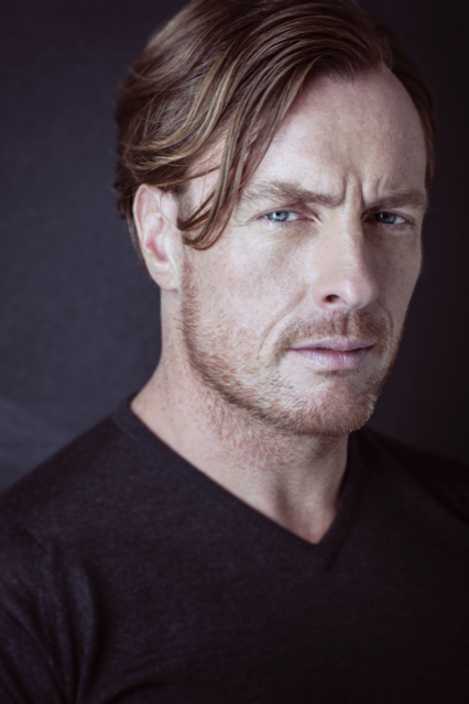 headshot of a white male actor