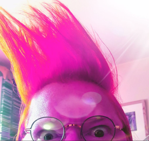 Person with large pink quiff