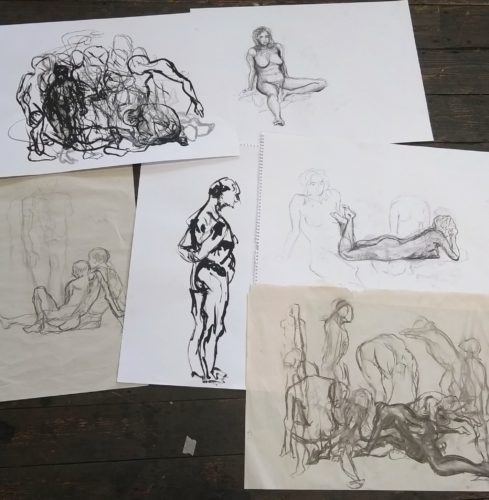 image showing 6 black and white life drawings laid out on the floor.