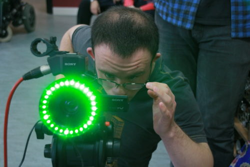 A filmmaker with a disability uses a specialist green-screen camera
