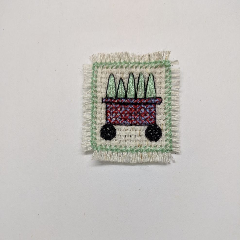 Cross stitch of a small succulent plant