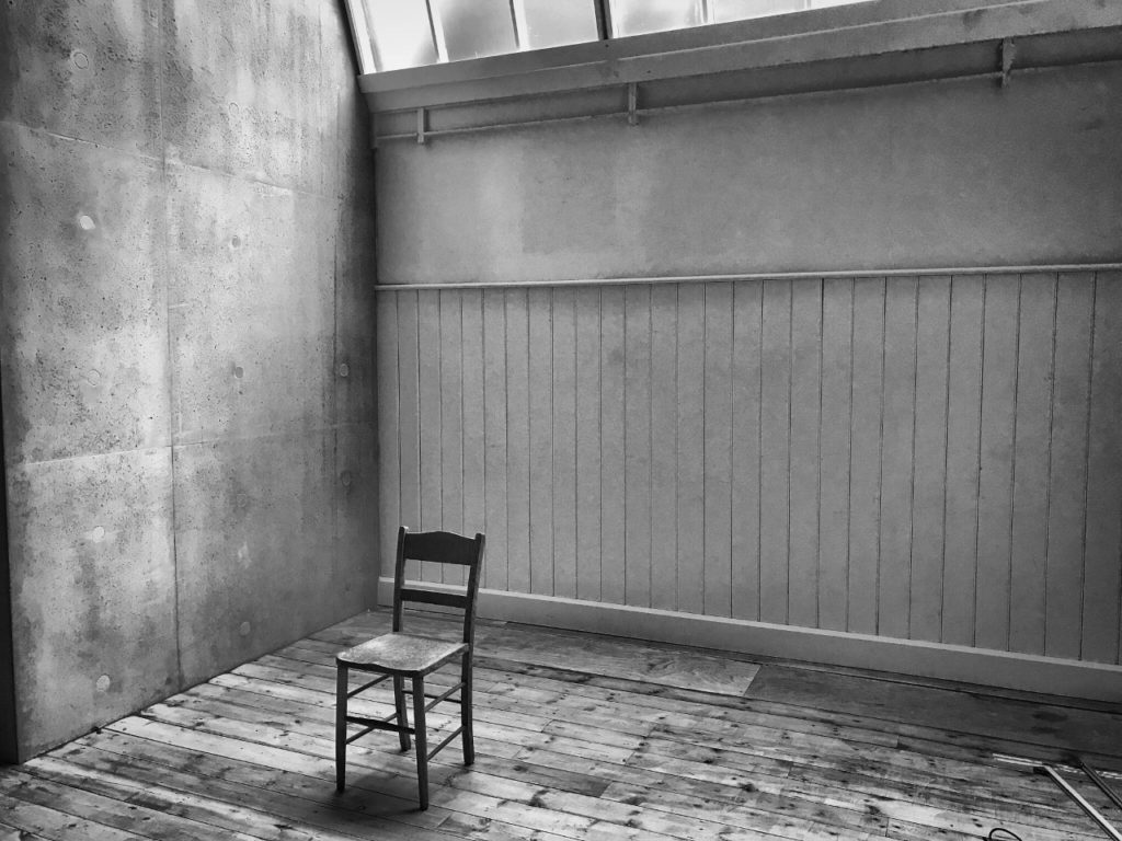 a black and white photo of the inside of a gallery space
