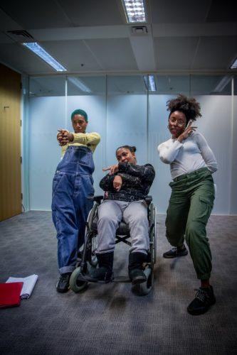 play rehearsal photo of three black women