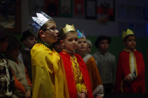 School children dressed as the 3 wise men in a nativity play