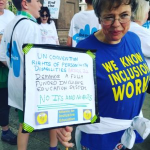 the author photgraphed at an inclusive education rally