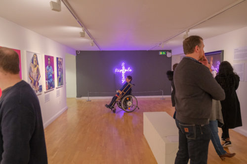 Group of people admiring an art exhibtion