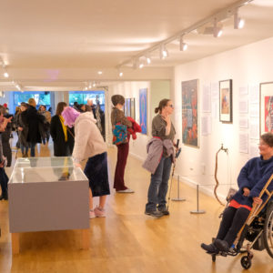 People looking round intently at an art exhibition