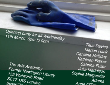 A pair of blue plastic gloves used for cleaning and other rough jobs, sits on a window cill. The details of the art show are below.