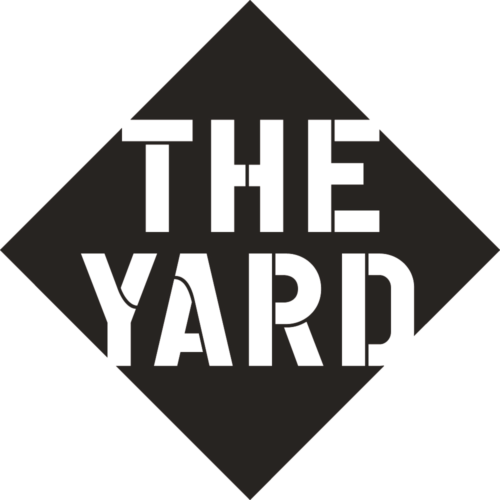 "This is a black and white logo saying ""The Yard"""