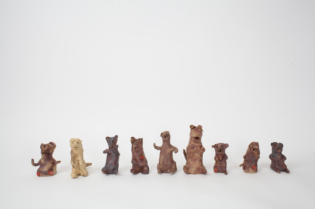 Line of small weasel sculptures