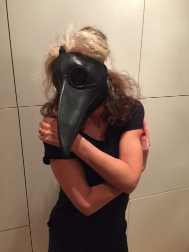 Woman with a crow's mask on