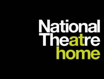 National Theatre home Logo. National Theatre is written in white apart from the at from theatre. This and home is in green. All on a black background.