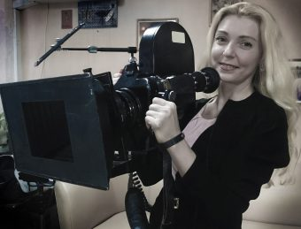 Portrait of filmmaker Anna Barsukova, with a camera