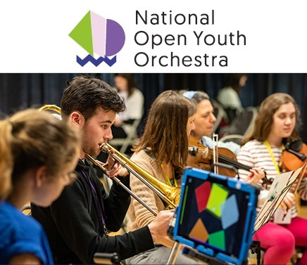 Young people playing instruments, one using eye-gaze technology.
